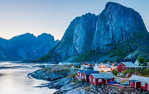 Red homes in                                                        front of mountains                                                        in Lofoten                                                        Islands